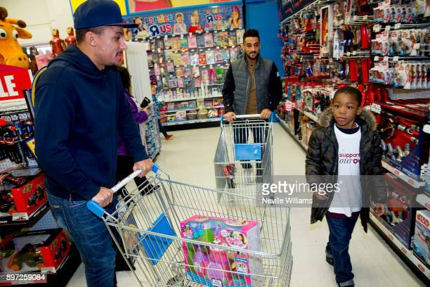 Aston Villa players Neil Taylor and Gabriel Agbonlahor join the Hayden family from Kingstanding Birmingham on a 'Supermarket Sweep' at the Toys 'R'...