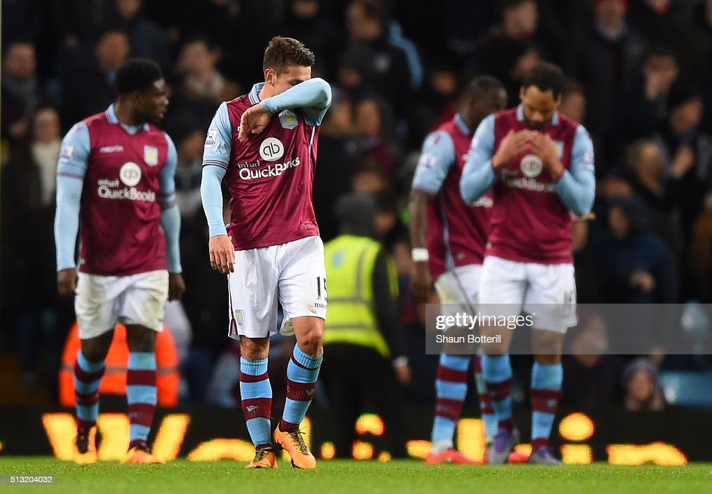 Aston Villa players show their dejection after Everton's third goal during the Barclays Premier League match between Aston Villa and Everton at Villa Park on March 1, 2016 in Birmingham, England.
