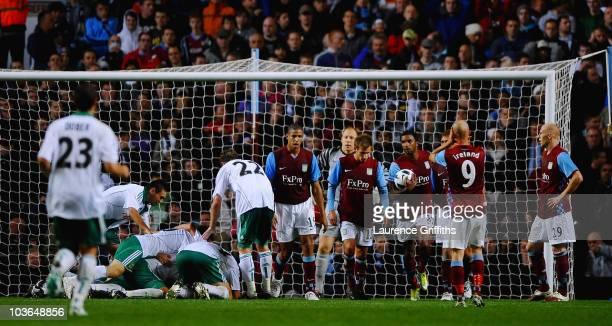 Aston Villa players show their disappointment as conceding the third goal during the UEFA Europa League play off second leg match between Aston Villa...