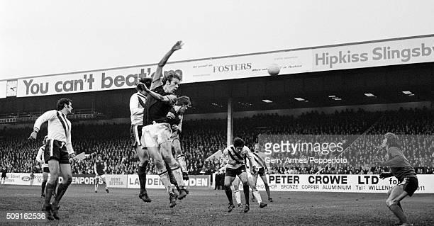Aston Villa striker Andy Gray heads the ball towards the Sheffield United goal during their First Division match at Villa Park in Birmingham 8th...