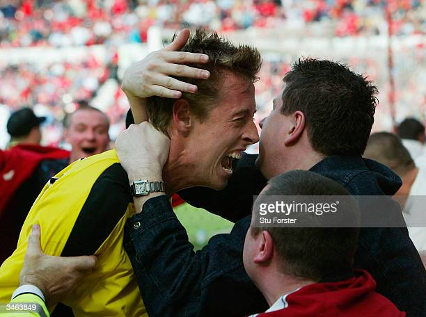 Aston Villa striker Peter Crouch is congratulated by fans after his last minute winner during the FA Barclaycard Premiership match between...