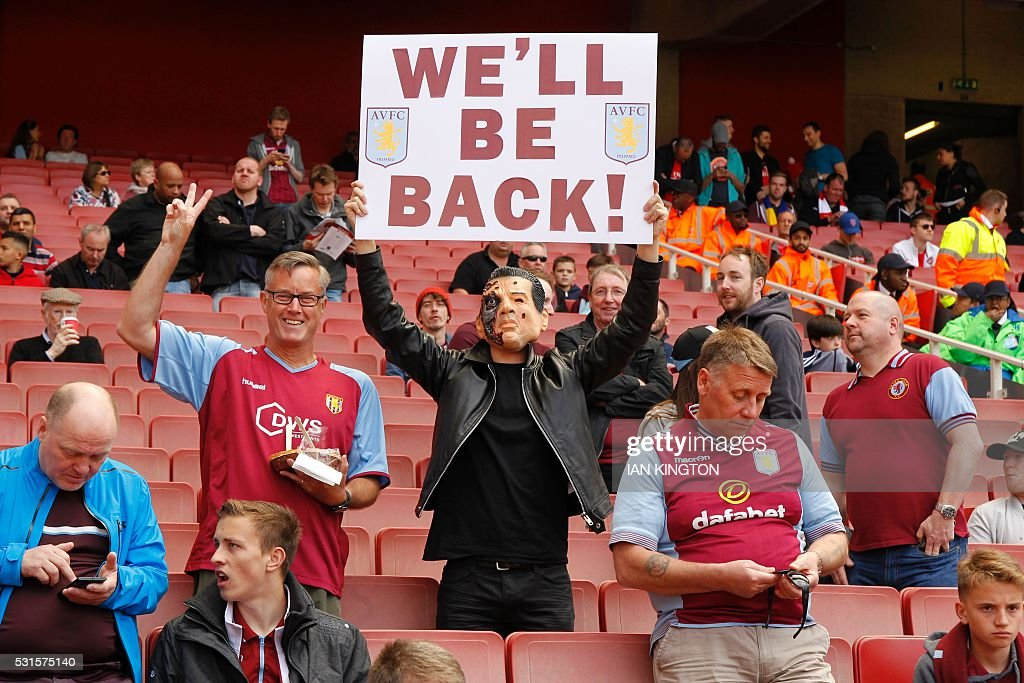 Aston Villa supporter holds a placard that reads 'We'll be Back' ahead of the English Premier League football match between Arsenal and Aston Villa at the Emirates Stadium in London on May 15, 2016. / AFP / Ian Kington / RESTRICTED TO EDITORIAL USE. No use with unauthorized audio, video, data, fixture lists, club/league logos or 'live' services. Online in-match use limited to 75 images, no video emulation. No use in betting, games or single club/league/player publications. /