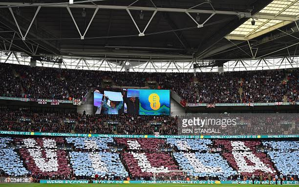 Aston Villa supporters hold up coloured placards to spell the name of their team prior to the start of the FA Cup semifinal between Aston Villa and...