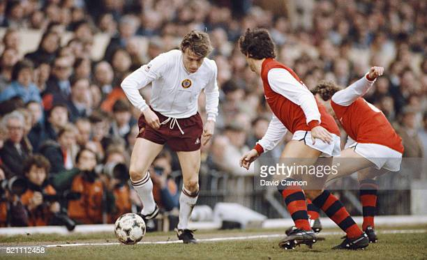 Aston Villa winger Tony Morley takes on Graham Rix and Kenny Sansom of Arsenal during a First Division match at Highbury on March 12 1983 in London...