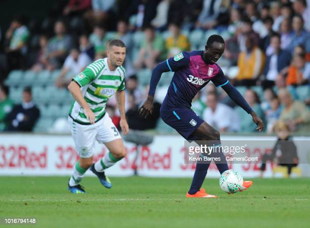 Aston Villa's Albert Adomah under pressure from Yeovil Town's Carl Dickinson during the Sky Bet League Two match between Yevoil Town and Mansfield...
