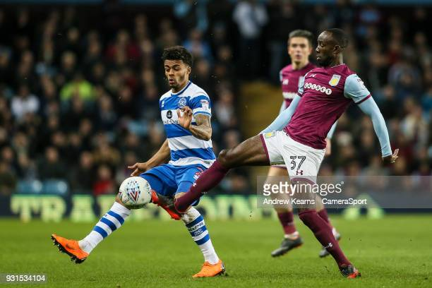 Aston Villa's Albert Adomah vies for possession with Queens Park Rangers' Darnell Furlong during the Sky Bet Championship match between Aston Villa...