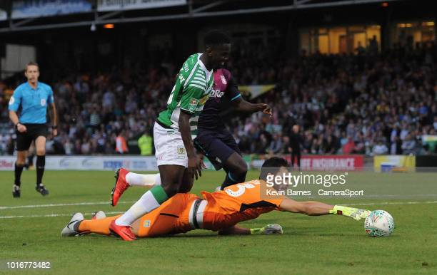 Aston Villa's Andre Moreira attempts to gather the ball under pressure from Yeovil Town's Diallang Jaiyesimi during the Sky Bet League Two match...