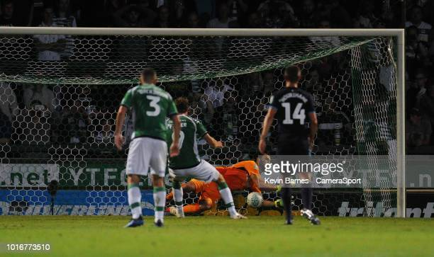 Aston Villa's Andre Moreira saves Yeovil Town's Alex Fisher's penalty during the Sky Bet League Two match between Yevoil Town and Mansfield Town at...