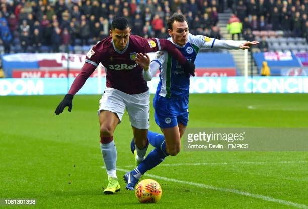 Aston Villa's Anwar El Ghazi and Wigan Athletic's Kal Naismith battle for the ball Wigan Athletic v Aston Villa Sky Bet Championship DW Stadium