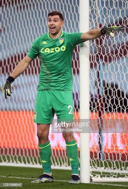 Aston Villa's Argentinian goalkeeper Emiliano Martinez gestures during the English Premier League football match between Aston Villa and...