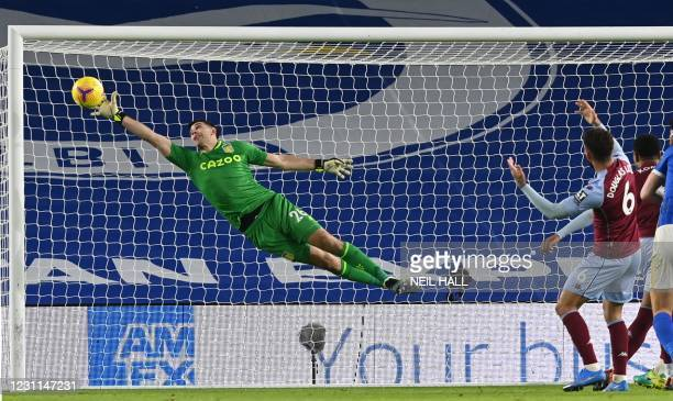 Aston Villa's Argentinian goalkeeper Emiliano Martinez makes a save during the English Premier League football match between Brighton and Hove Albion...