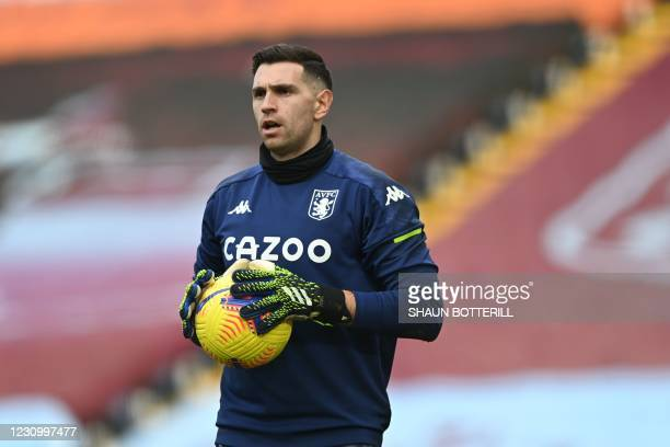 Aston Villa's Argentinian goalkeeper Emiliano Martinez warms up ahead of the English Premier League football match between Aston Villa and Arsenal at...