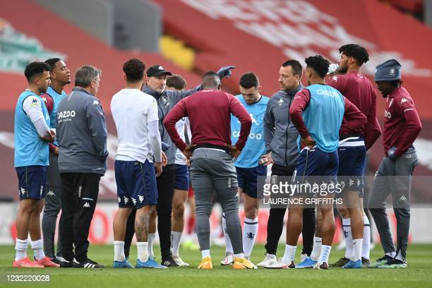 Aston Villa's assistant head coach Richard O'Kelly and manager John Terry talk to the players ahead of the English Premier League football match...