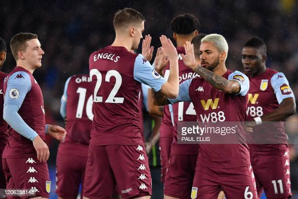 Aston Villa's Belgian defender Bjorn Engels and Aston Villa's Brazilian midfielder Douglas Luiz 'high five' on the pitch ahead of the English Premier...
