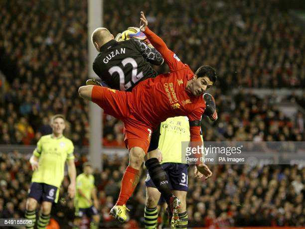 Aston Villa's Bradley Guzan makes a save from Liverpool's Luis Suarez
