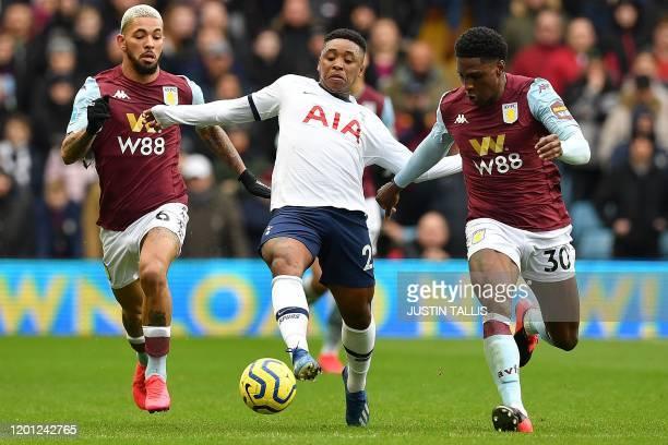 Aston Villa's Brazilian midfielder Douglas Luiz and Aston Villa's English defender Kortney Hause vie with Tottenham Hotspur's Dutch midfielder Steven...