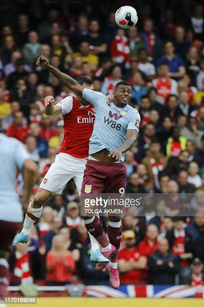 Aston Villa's Brazilian striker Wesley vies with Arsenal's Greek defender Sokratis Papastathopoulos during the English Premier League football match...