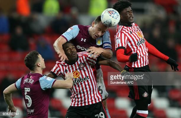 Aston Villa's captain John Terry center battles for the ball with Sunderland's Joel Asoro left and Josh Maja right during the Sky Bet Championship...
