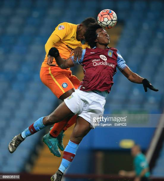 Aston Villa's Carlos Sanchez and Wycombe Wanderers' Aaron Pierre battle for the ball in the air