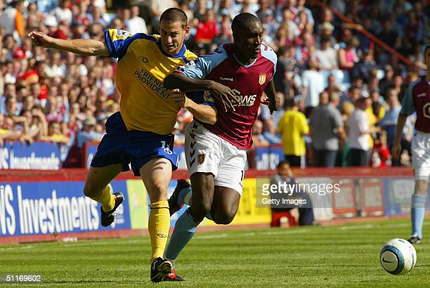 Aston Villa's Carlton Cole battles with Southampton's Rory Delap during the Barclays Premiership match between Aston Villa and Southampton at Villa...