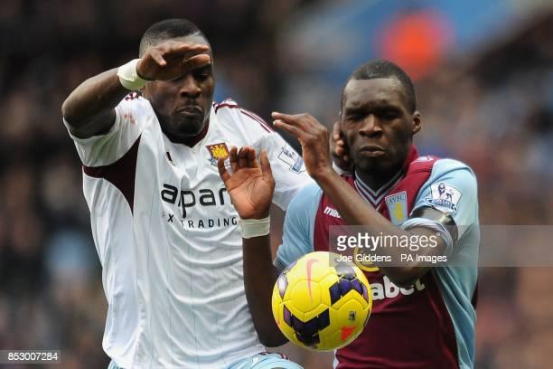 Aston Villa's Christian Benteke and West Ham United's Guy Demel battle for the ball during the Barclays Premier League match at Villa Park Birmingham