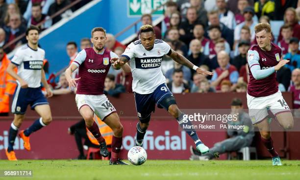 Aston Villa's Conor Hourihane and Middlesbrough's Britt Assombalonga battle for the ball during the Sky Bet Championship Playoff match at Villa Park...