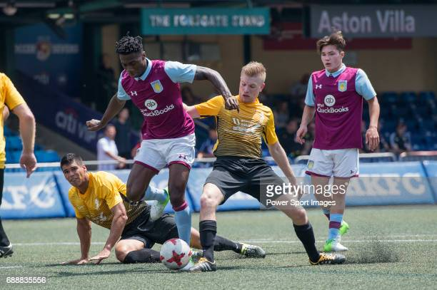 Aston Villa's Corey Taylor competes with Singapore Cricket Club's Jack Cullinan for a ball during their Main Tournament match part of the HKFC Citi...