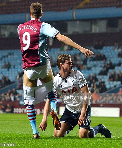 Aston Villa's Danish forward Nicklas Helenius loses his shorts during a challenge from Tottenham Hotspur's Belgian defender Jan Vertonghen at the...