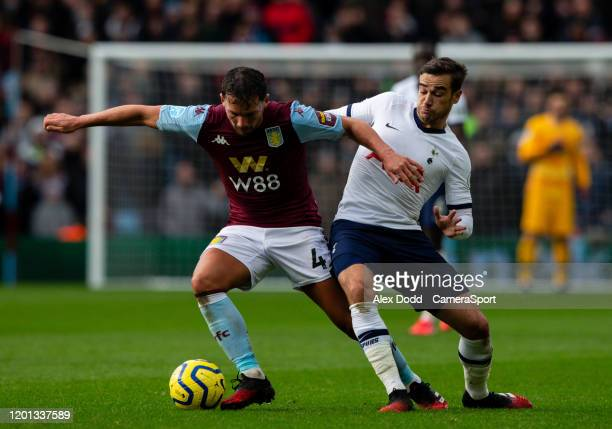 Aston Villa's Danny Drinkwater vies for possession with Tottenham Hotspur's Harry Winks during the Premier League match between Aston Villa and...
