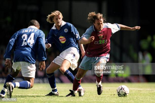 Aston Villa's David Ginola turns away from Leicester City's Robbie Savage and Andrew Impey