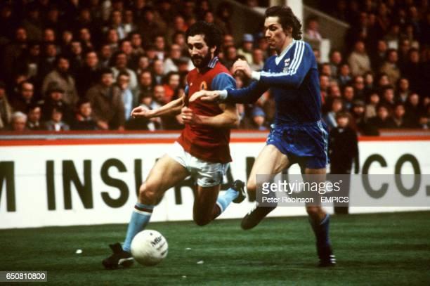 Aston Villa's Dennis Mortimer takes on Ipswich Town's Arnold Muhren