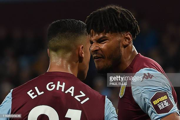 TOPSHOT Aston Villa's Dutch striker Anwar El Ghazi remonstrates with teammate Aston Villa's English defender Tyrone Mings during the English Premier...