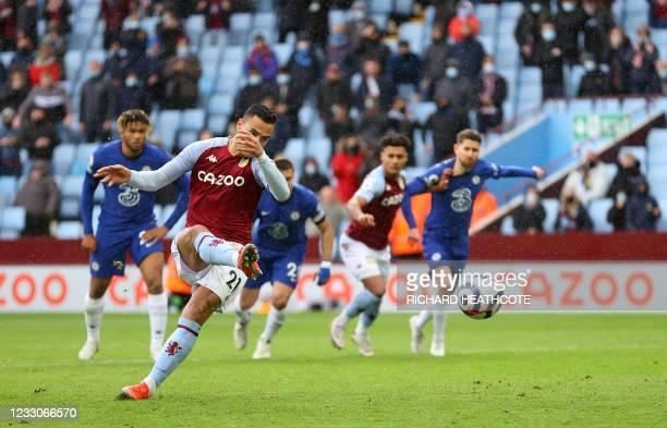 Aston Villa's Dutch striker Anwar El Ghazi scores his team's second goal from the penalty spot during the English Premier League football match...