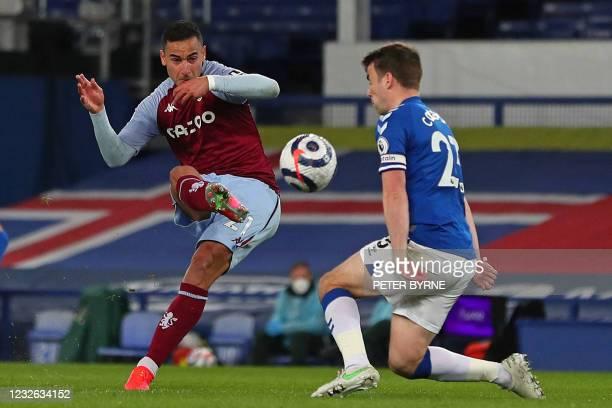 Aston Villa's Dutch striker Anwar El Ghazi shoots past Everton's Irish defender Seamus Coleman to score their second goal during the English Premier...