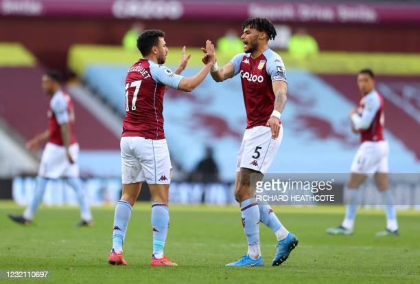 Aston Villa's Egyptian midfielder Trezeguet celebrates scoring a goal with Aston Villa's English defender Tyrone Mings during the English Premier...