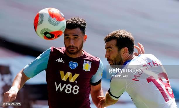 Aston Villa's Egyptian midfielder Trezeguet fight fights for the ball with Crystal Palace's Scottish midfielder James McArthur during the English...