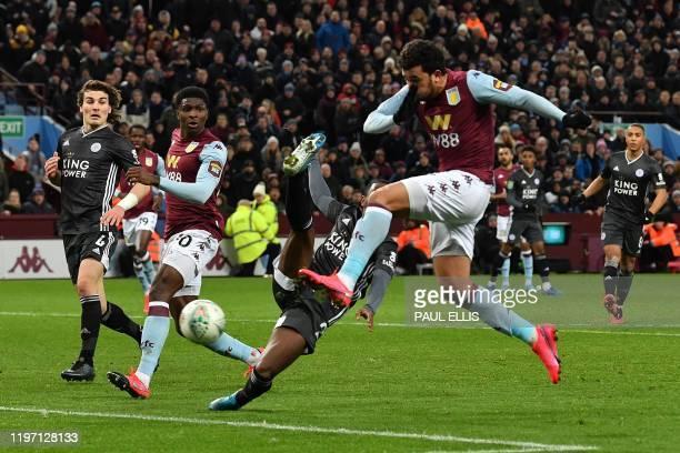 Aston Villa's Egyptian midfielder Trezeguet scores his team's second goal during the English League Cup semifinal second leg football match between...