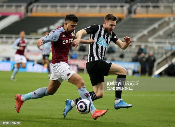 Aston Villa's Egyptian midfielder Trezeguet vies for the ball against Newcastle United's Welsh defender Paul Dummett during the English Premier...