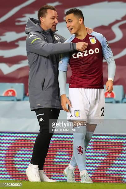 Aston Villa's English assistant coach John Terry speaks with Aston Villa's Dutch striker Anwar El Ghazi after the English Premier League football...