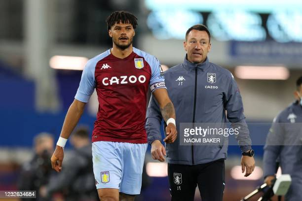 Aston Villa's English assistant coach John Terry speaks with Aston Villa's English defender Tyrone Mings on the pitch after their win in the English...