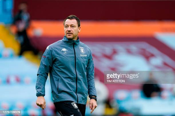 Aston Villa's English assistant coach John Terry watches his team players before the start of the English Premier League football match between Aston...