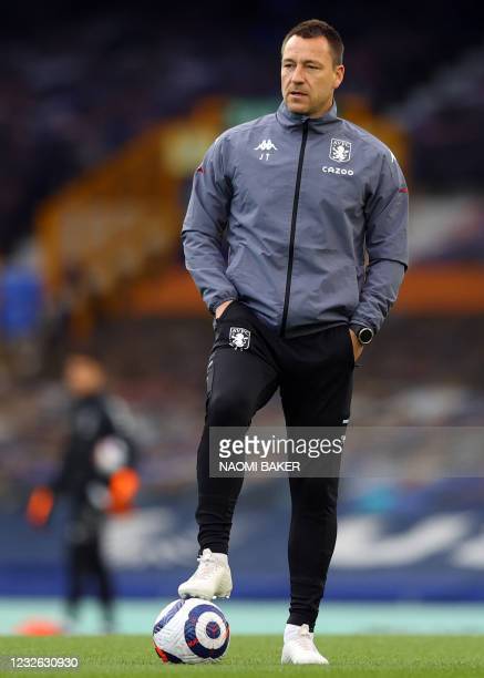 Aston Villa's English assistant coach John Terry watches the players warm up during the English Premier League football match between Everton and...