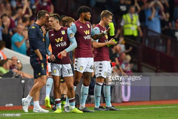 Aston Villa's English assistant manager John Terry talks with English midfielder Jack Grealish during the English Premier League football match...