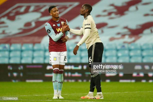 Aston Villa's English defender Ezri Konsa shakes hands with Manchester United's French midfielder Paul Pogba at the end of the English Premier League...