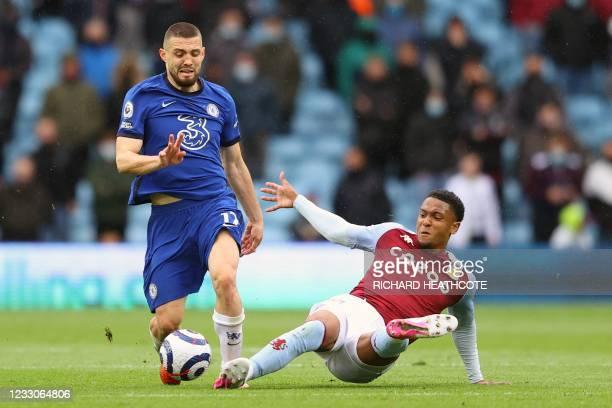 Aston Villa's English defender Ezri Konsa tackles Chelsea's Croatian midfielder Mateo Kovacic during the English Premier League football match...