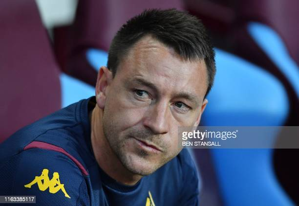 Aston Villa's English defender John Terry looks on from the dugout ahead the English Premier League football match between Aston Villa and Everton at...