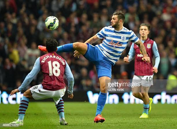 Aston Villa's English defender Kieran Richardson vies with Queens Park Rangers' English striker Charlie Austin during the English Premier League...