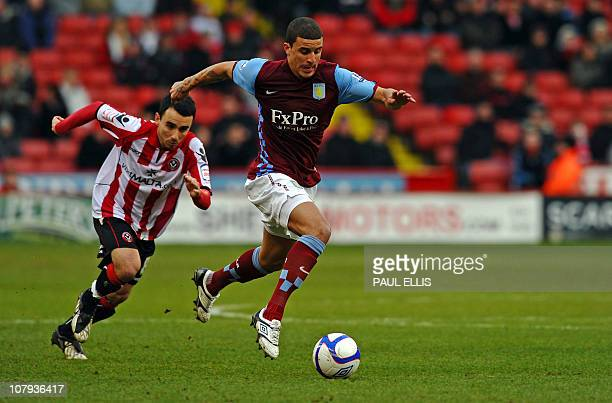 Aston Villa's English defender Kyle Walker is chased by Sheffield United's English midfielder Leon Britton during the FA Cup third round football...