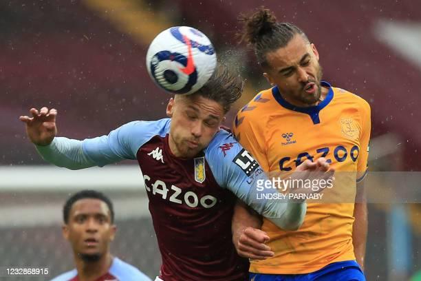 Aston Villa's English defender Matty Cash vies with Everton's English striker Dominic Calvert-Lewin during the English Premier League football match...