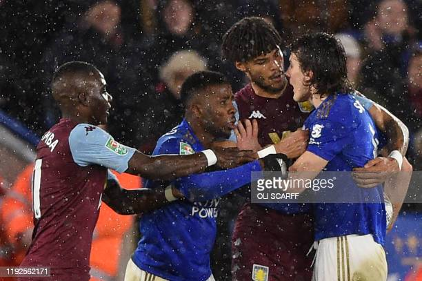 Aston Villa's English defender Tyrone Mings and Leicester City's Turkish defender Caglar Soyuncu discuss during the English League Cup semifinal...